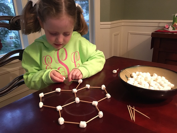 girl-building-snowflake-molecule-allison-sutcliffe