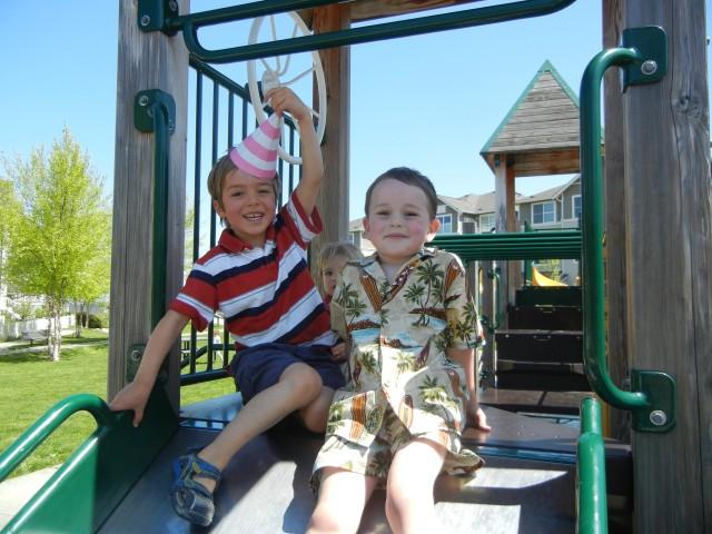 Birthday boys on slide