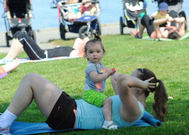 Mom sit ups with baby