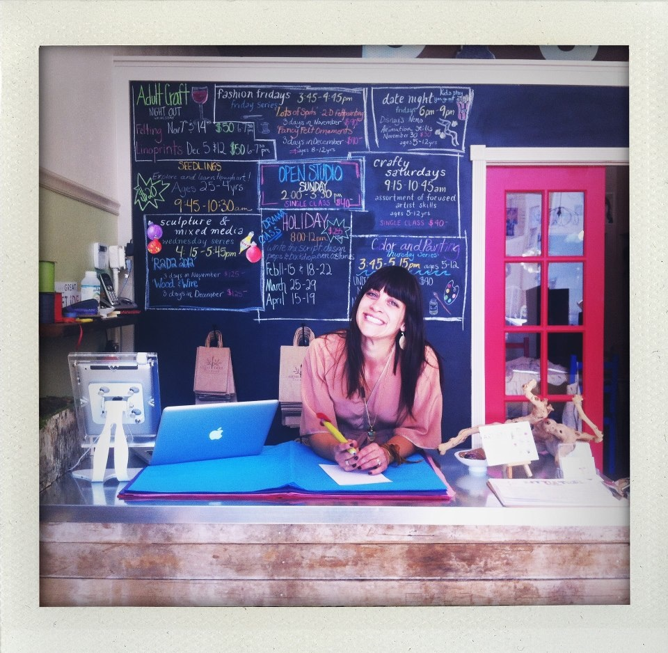 Owner Nichole Farnum behind the counter at Little Tree Studio and Store
