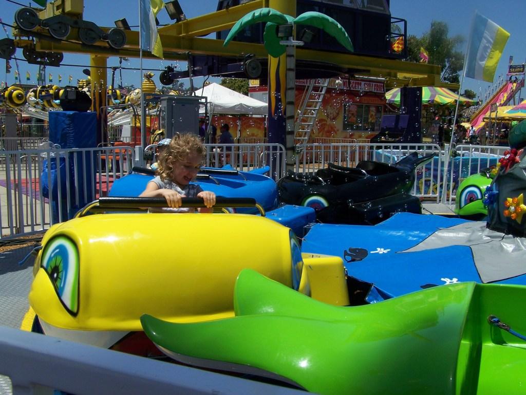 kid-at-amusement-park-ride