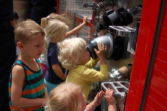 Kids with fire engine equipment