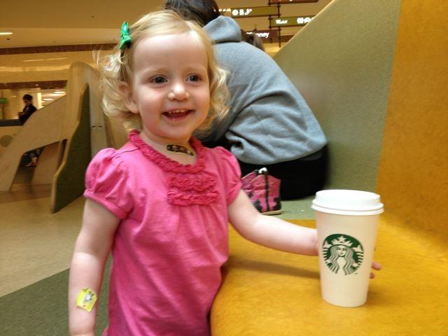 LIttle girl with starbucks coffee