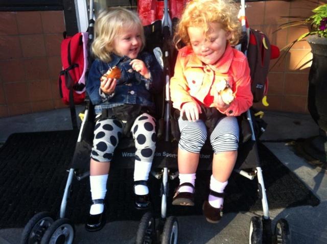Two girls in double stroller