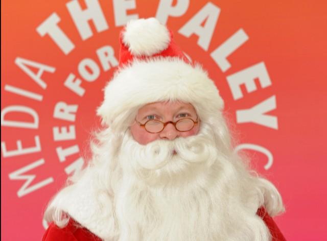 Santa in front of Paley logo