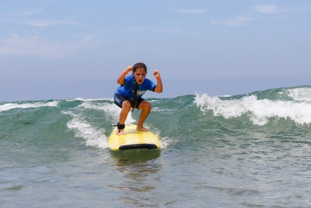 SurfDiva - thrilled surfer