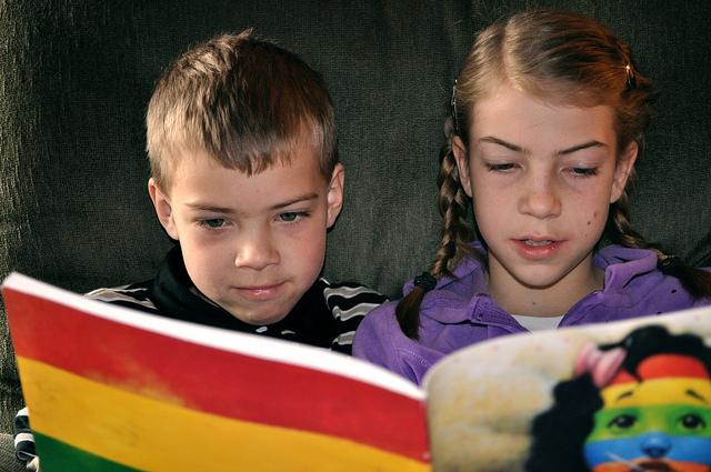 Kids reading rainbow book Carissa Rogers Flickr