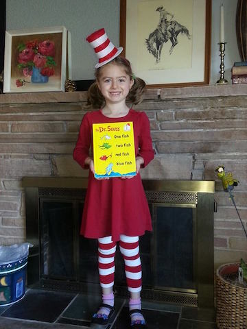 Girl with cat in the hat