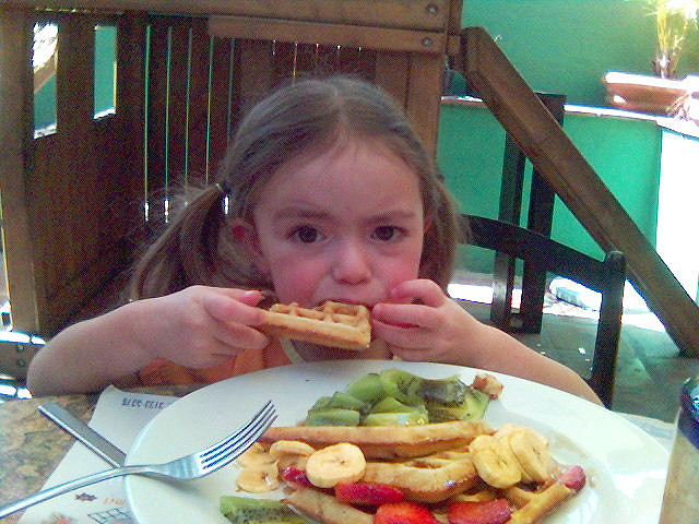 girl-eats-waffles