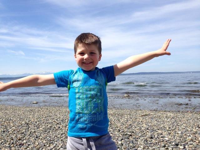 Boy on Alki beach open arms