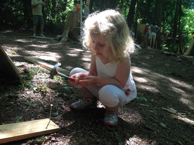 Girl hammering Adventure Playground