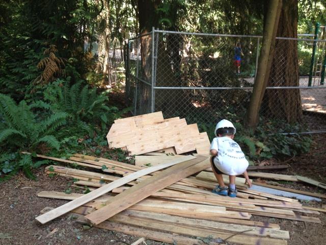 Boy at wood pile Adventure Playground