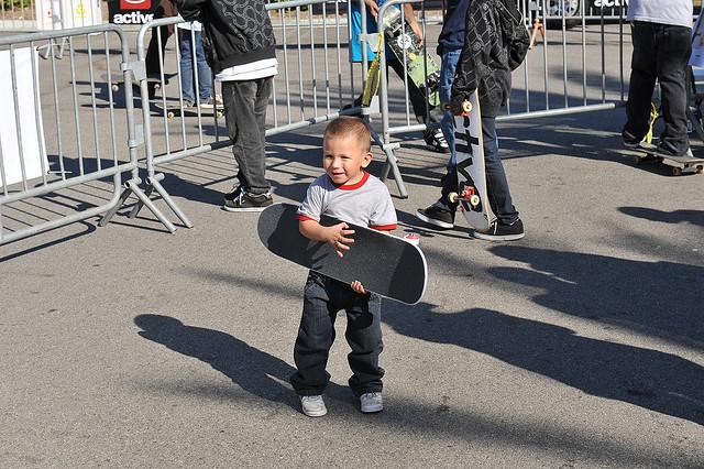 Kid Holding Skateboard