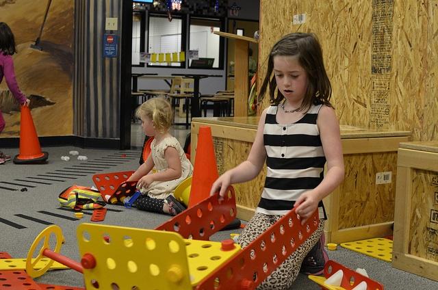 Girls Play construction zone Imagine Children's Museum