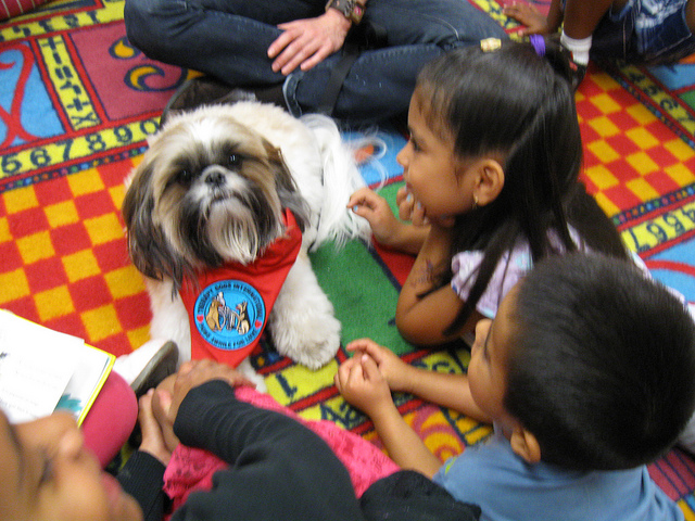kids and dog at library