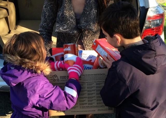 kids filling food drivng box (2)