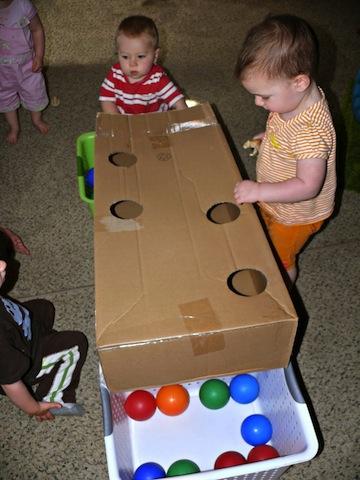holeinabox_cardboardboxfun_bump+baby_redtricycle