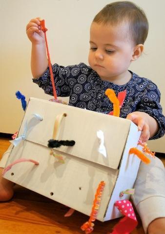 tuggingbox_cardboardboxplay_bump+baby_redtricycle