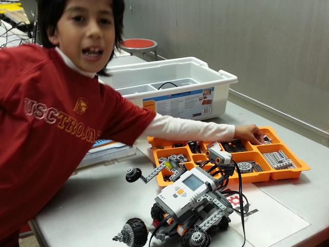 Boy-Lego-Mindstorms-Rolling-Robots