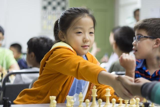 Chess4Life girl handshake