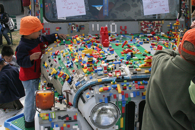 car with legos at maker faire with kid