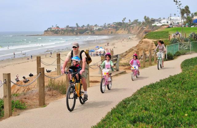 Pacific-Beach-Boardwalk-Cyclists-Courtesy-Brett-Shoaf-Artistic-Visuals