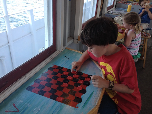 Playing checkers on ice cream cruise