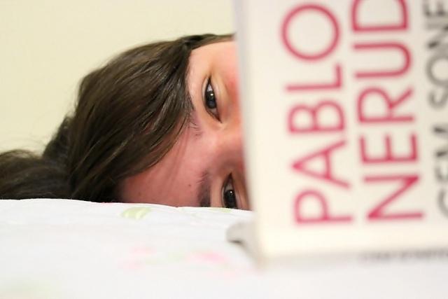 girl reading pablo neruda book