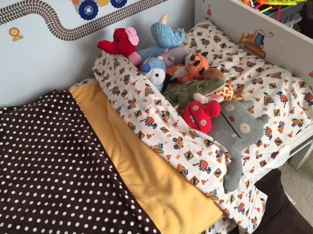 bed full of stuffed animals