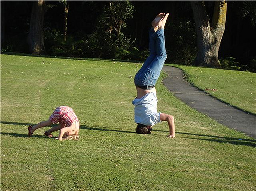 kid and dad head stand