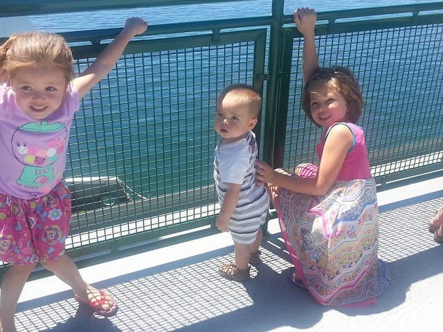 Baby and sisters riding ferry