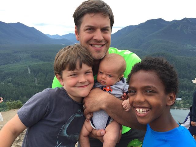 Family hiking 4 boys