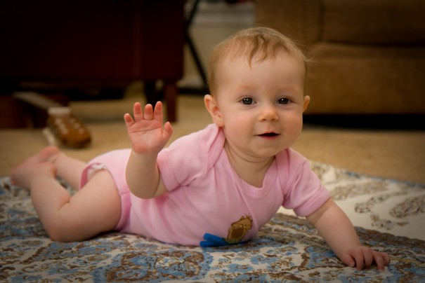 Baby waving-Dean Wissing-flickr
