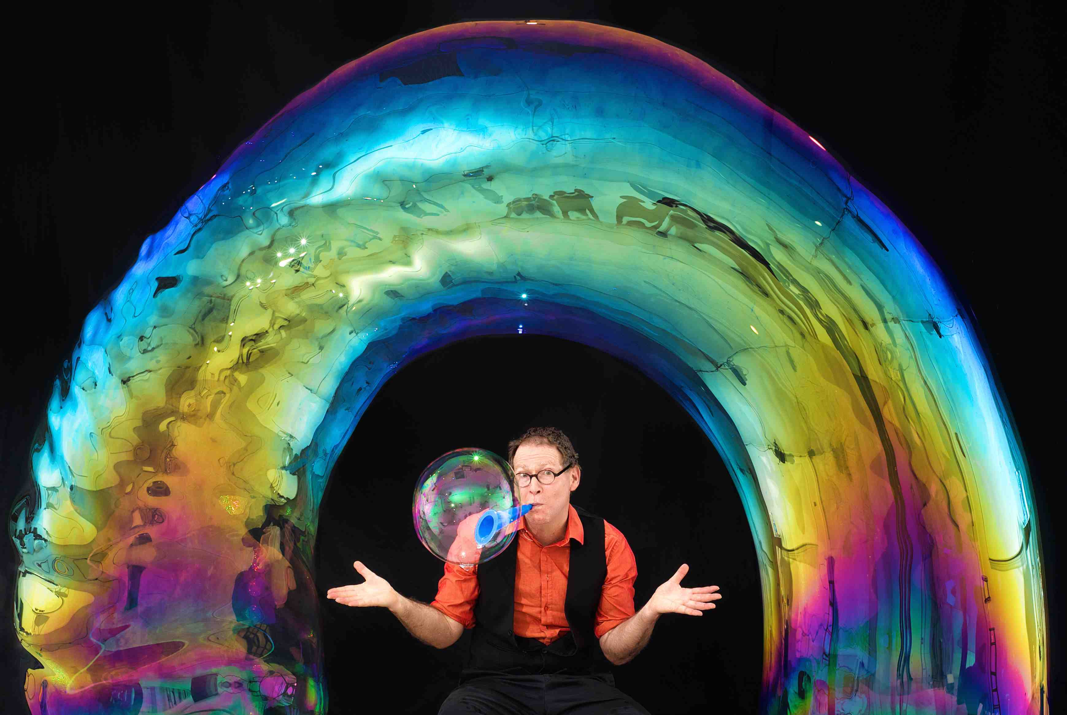 The Amazing Bubble Man has been thrilling audiences around the world for nearly 30 years with the art, magic, science and fun of bubbles. An Edinburgh Fringe favorite, he has sold out every year for the last seven years. The Amazing Bubble Man (aka Louis Pearl) explores the breath-taking dynamics of bubbles, combining comedy and artistry with audience participation and enough spellbinding bubble tricks to keep everyone mesmerized. From square bubbles, bubbles inside bubbles, fog-filled bubbles, giant bubbles, bubble volcanoes, tornados and trampolines to people inside bubbles, the Amazing Bubble Man conjures shrieks of laughter and gasps of amazement from all ages. The shows will also feature multi instrumentalist Jet Black Pearl accompanying with bubbly music to double your pleasure. www.bubbleguy.com
