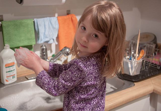 kid doing dishes