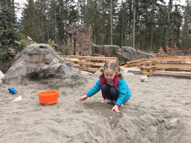 Girl in sand pit at Kids Trek