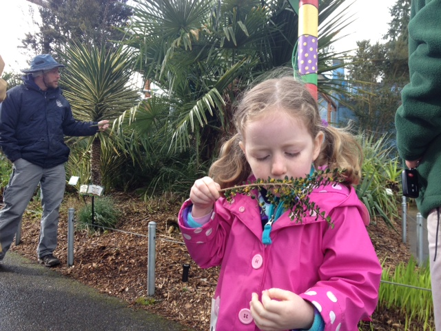 zoo garden tour girl smelling plant