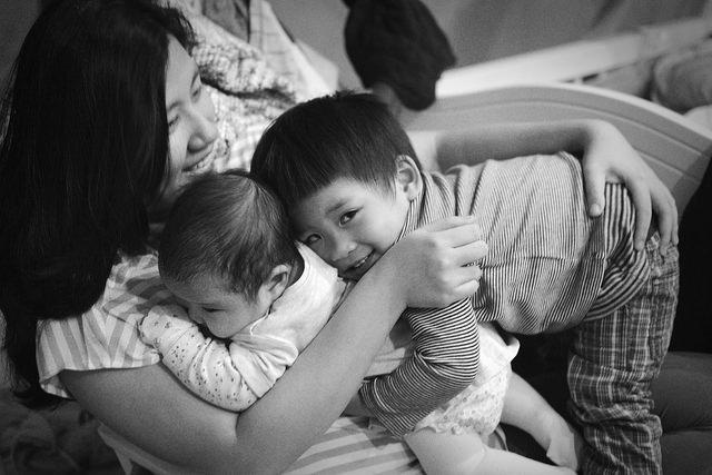 mom and kids hugging