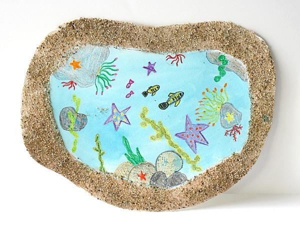 Buggy y Buddy - Arte en la arena de la piscina de mareas