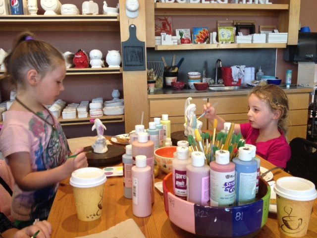 Girls painting pottery in Gig Harbor