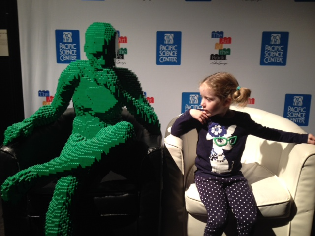 Girls stares at green lego mang PSC