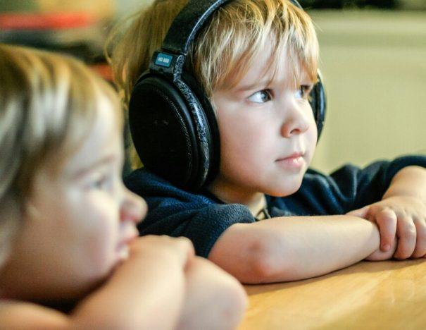 twins and headphones