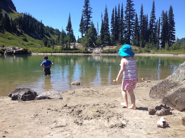 kids wading in mountain lake
