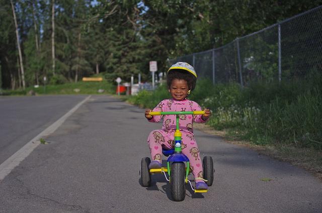 LIttle girl on trike pjs mazaletel flickr cc
