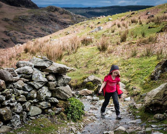 kid in nature, stream, rocks