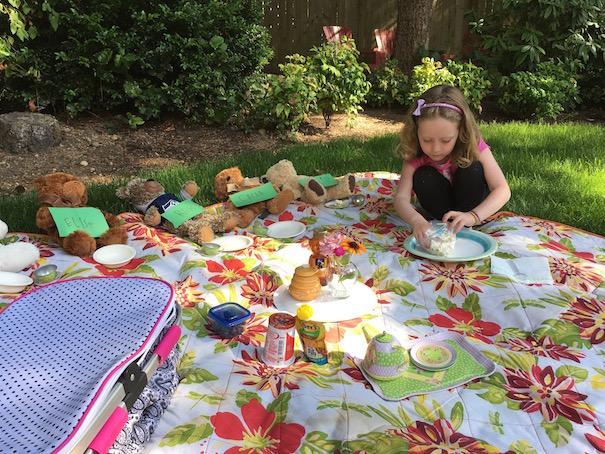 feeding teddies on picnic