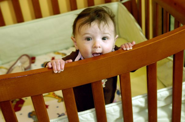 baby-standing-in-crib