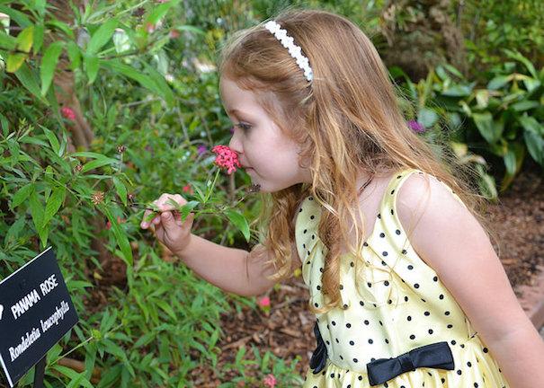 girl-smelling-flowers-walter-via-flickr