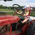 GirlonTractor-Frying Pan Park Farm via Jennifer Massoni Pardini