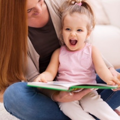 girl laughing with mom reading jokes for kids fun happy